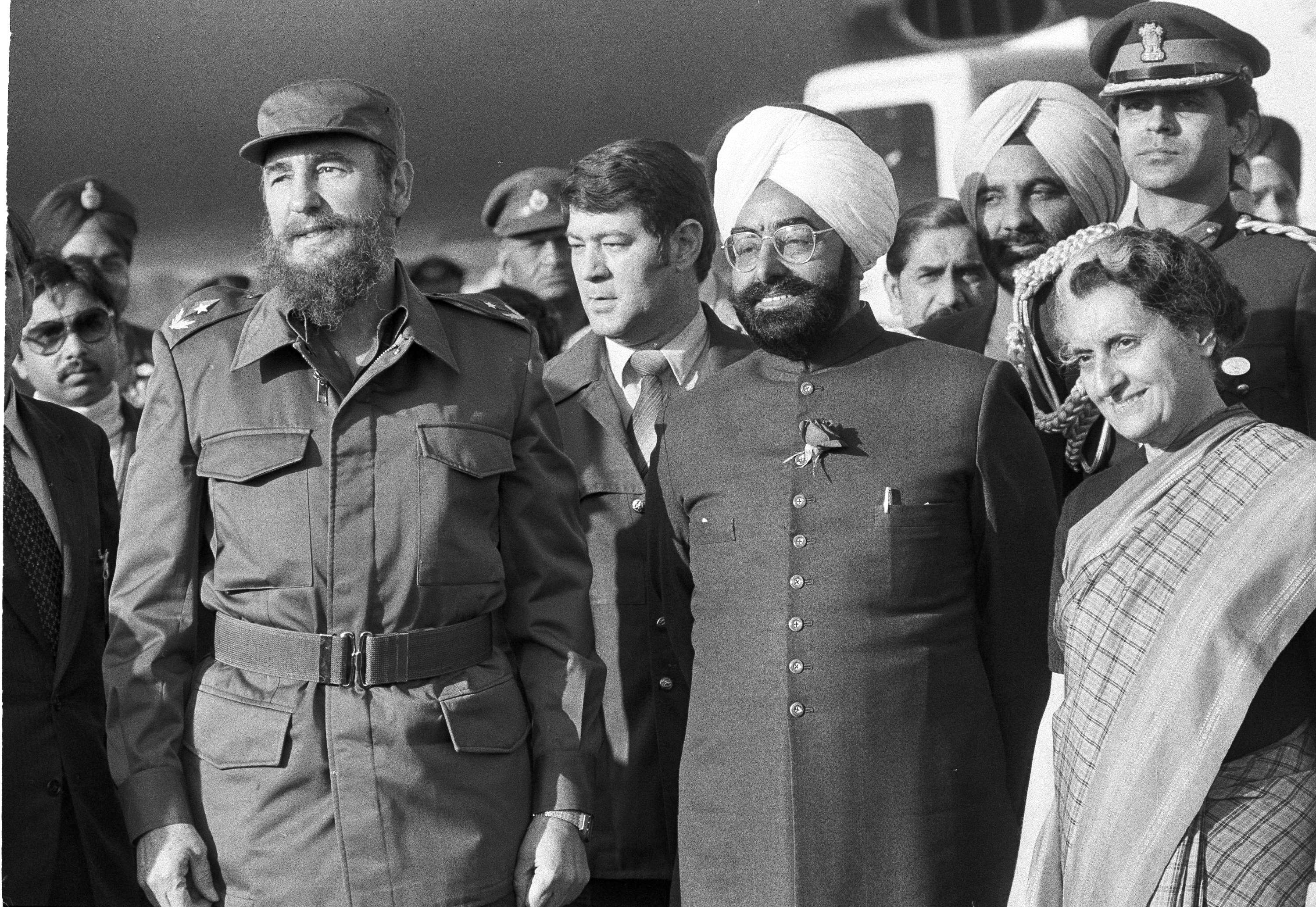 Cuban Prime Minister Fidel Castro, left, Indian President Zail Singh, and Indian Prime Minister Indira Gandhi pose for photographers after Castro arrived in New Delhi, March 6, 1983.