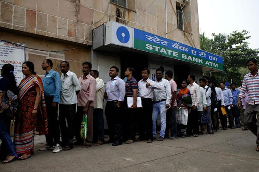 People stand in the queue to enter into the bank to withdraw money and exchange the discontinued notes in Bhubaneswar, India, November 11, 2016.