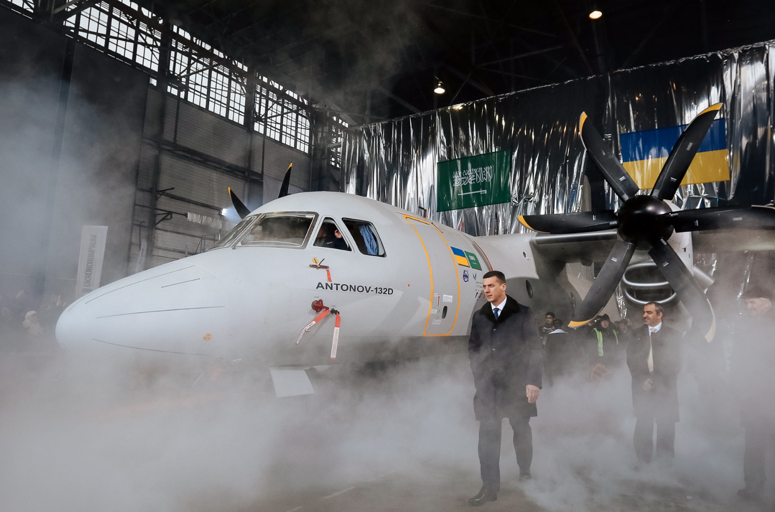 Guests attend the presentation of the new AN-132D aircraft demonstrator in the final assembly shop of the Antonov aircraft plant in Kiev, 20 December 2016. Source: Vostock-Photo