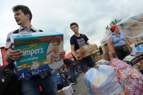 La raccolta di aiuti a Mosca da inviare alle popolazioni alluvionate della Russia del Sud (Foto: Itar-Tass)