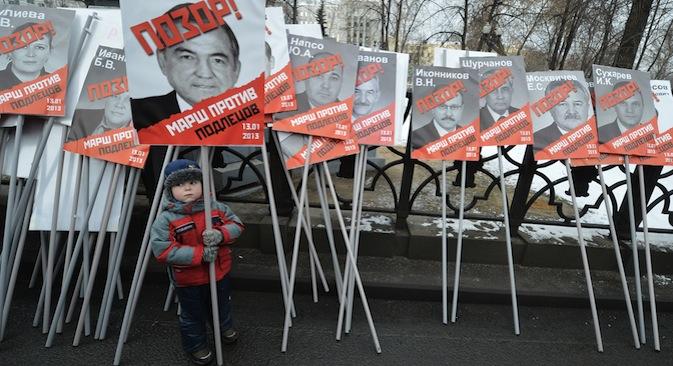 La marcia contro la legge anti-adozioni del 13 gennaio 2013 a Mosca (Foto: RIA Novosti / Ilya Pitalev)