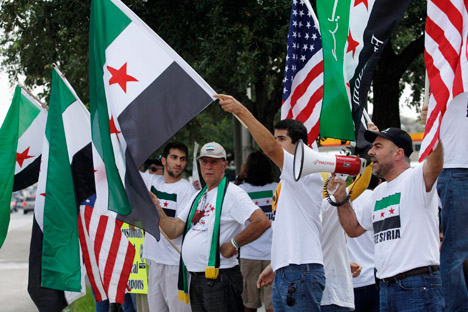 Proteste a Houston contro l'intervento americano in Siria, il 31 agosto 2013 (Foto: AP)