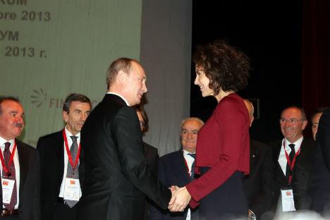 Vladimir Putin durante uno degli incontri economici del vertice (Foto: Evgeny Utkin)