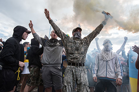 Porre fine agli scontri e la sicurezza dei giornalisti: questi gli argomenti chiave del colloquio tra Putin e Poroshenko (Foto: Photoshot/Vostockphoto)