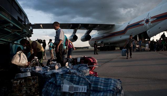 L'arrivo di alcuni rifugiati (Foto: AFP/East News)