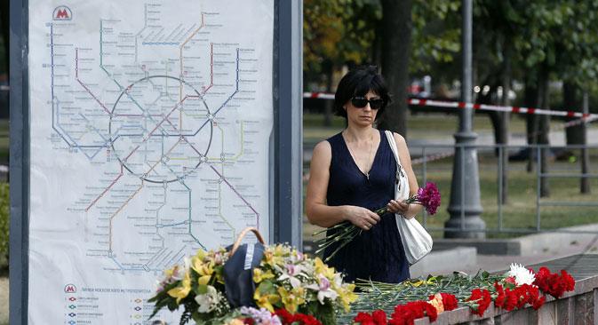 Fiori in una città in lutto (Foto: Itar Tass)