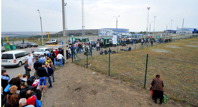 Rifugiati ucraini in fuga (Foto: Sergei Pivovarov/RIA Novosti)