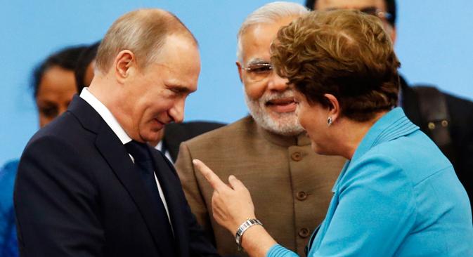 Il Presidente russo Vladimir Putin con il Presidente brasiliano Dilma Rousseff (Foto: Reuters)