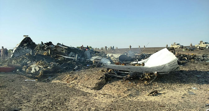 Debris from crashed Russian jet lies strewn across the sandat the site of the crash in Sinai, Egypt, Oct. 31.