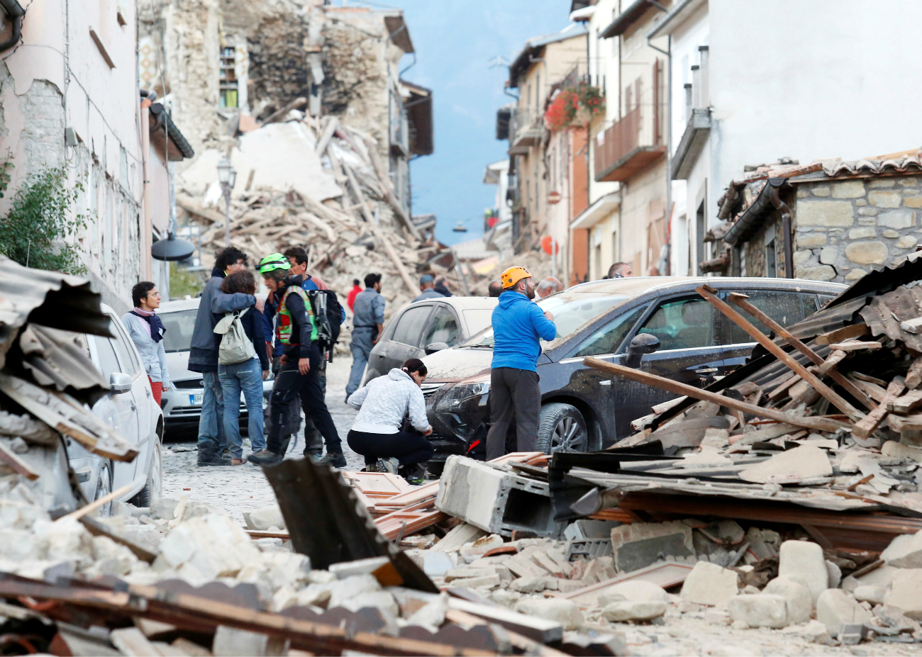People stand along a road following a quake in Amatrice, central Italy, Aug. 24, 2016.