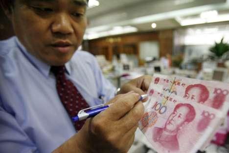 中国政府は人民元を金本位にする可能性がある。 =AP通信撮影