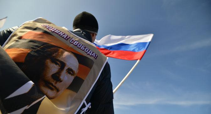3月18日、プーチン大統領は、クリミアをロシアに編入する条約に署名した。=ロシア通信撮影