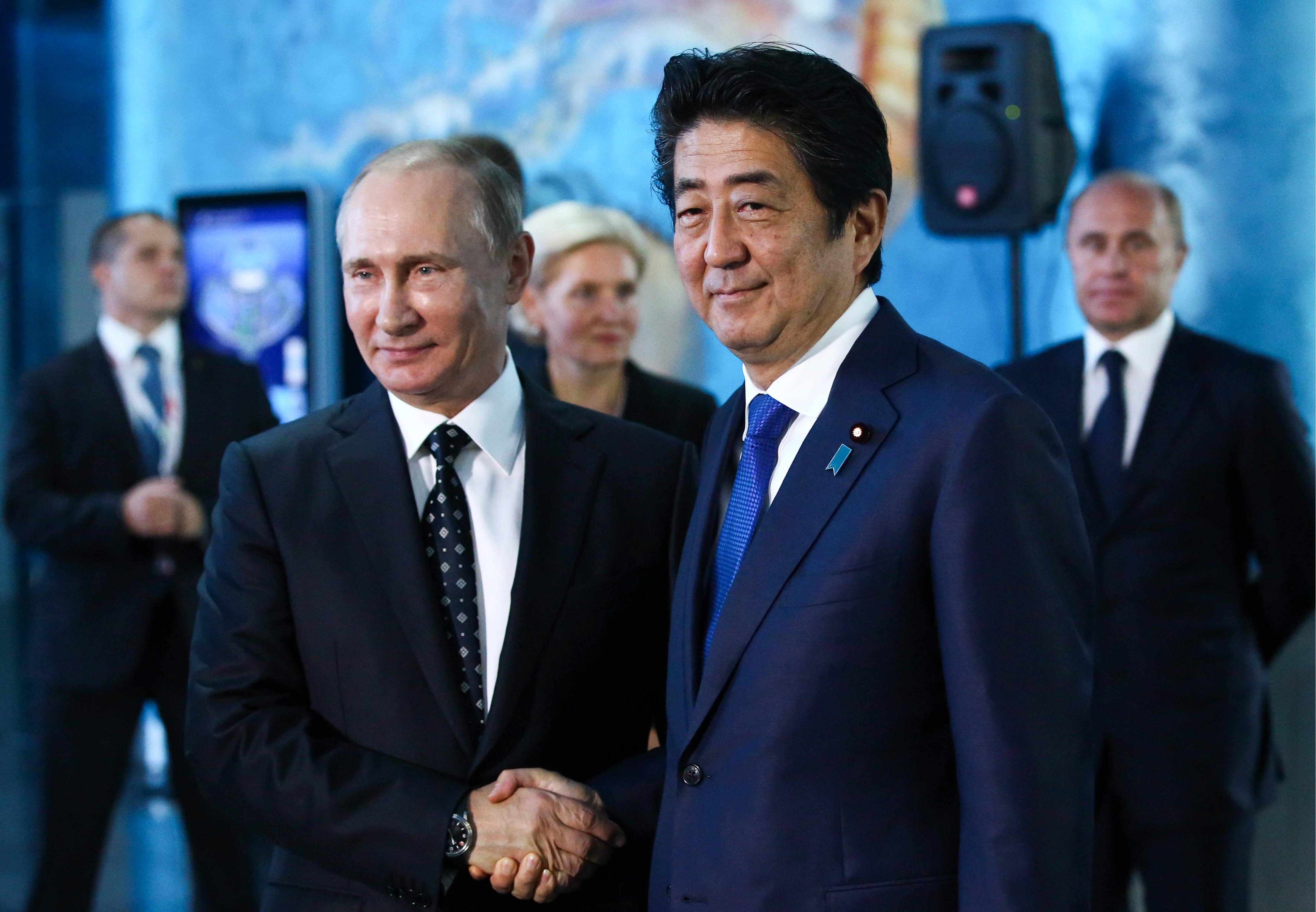 Russian President Vladimir Putin and Japanese Prime Minister Shinzo Abe at the Eastern Economic Forum in the Russian city of Vladivostok.