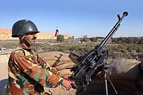 Припадник сиријске војске. Извор: Reuters / Vostock Photo.