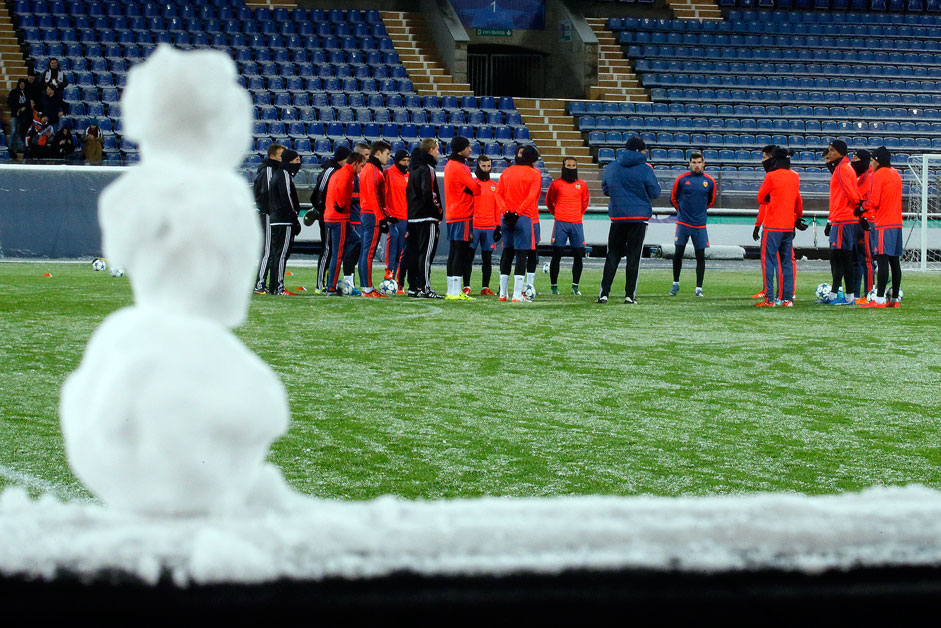 A snowman is made on the side of the pitch as Valencia players attend a training session in St. Petersburg, Russia, Monday, Nov. 23, 2015, ahead of the Champions League, group H, soccer match, between Valencia and Zenit St. Petersburg on Tuesday.