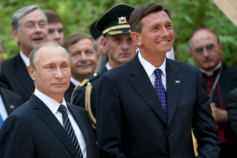 Ruski predsednik Vladimir Putin in slovenski predsednik Borut Pahor sta se na Vršiču tudi nasmejala.