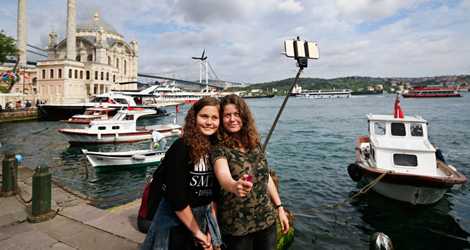 Russian tourists taking a selfie in Istanbul.