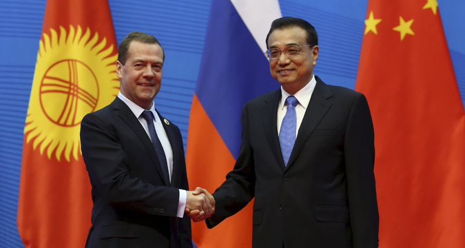 Russian Prime Minister Dmitry Medvedev and his Chinese Premier of the State Council of China Li Keqiang